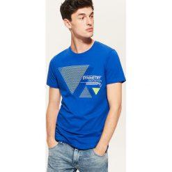 T-shirt z nadrukiem - Niebieski. Czarne t-shirty męskie z nadrukiem marki KIPSTA, z poliesteru, do piłki nożnej. Za 29,99 zł.