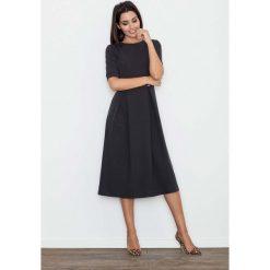 Czarna Sukienka Elegancka Wizytowa Midi. Czarne sukienki balowe marki Molly.pl, do pracy, l, z tkaniny, z okrągłym kołnierzem, z krótkim rękawem, midi, dopasowane. Za 145,90 zł.