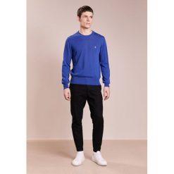 Vivienne Westwood Sweter indigo melange. Niebieskie swetry klasyczne męskie Vivienne Westwood, l, z bawełny. Za 1019,00 zł.