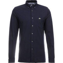 Lacoste Koszula navy blue. Szare koszule męskie marki Lacoste, l, w paski, z bawełny, z klasycznym kołnierzykiem, z długim rękawem. Za 509,00 zł.