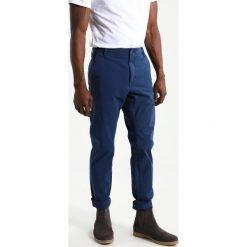 Chinosy męskie: DOCKERS ALPHA JOGGER WITH SMART 360 FLEX Spodnie materiałowe montecito blue