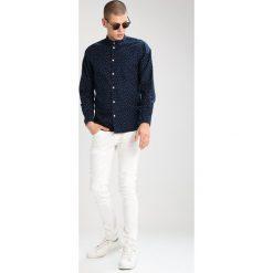 Tiger of Sweden Jeans Jeansy Slim Fit WHITE. Białe jeansy męskie relaxed fit marki Tiger of Sweden Jeans. W wyprzedaży za 463,20 zł.