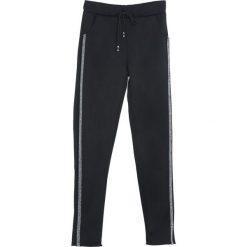 Czarne Spodnie Dresowe Patience. Czarne spodnie dresowe damskie marki Born2be, l. Za 49,99 zł.