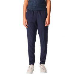 Bryczesy damskie: Adidas Spodnie damskie TrackPant granatowe r. 38 (CG1560)