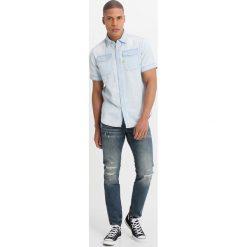 GStar 3301 SLIM Jeansy Slim Fit higa denim. Niebieskie jeansy męskie relaxed fit marki G-Star. W wyprzedaży za 395,40 zł.