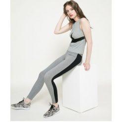 Nike - Legginsy. Szare legginsy skórzane Nike, s. W wyprzedaży za 119,90 zł.