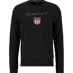 GANT SHIELD CNECK Bluza black. Czarne kardigany męskie marki GANT, m, z bawełny. W wyprzedaży za 341,10 zł.