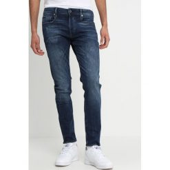 GStar Jeansy Slim Fit trender ultimate denim. Niebieskie jeansy męskie relaxed fit G-Star. Za 609,00 zł.