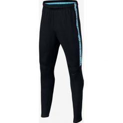 Chinosy chłopięce: Nike Spodnie dziecięce  B Dry Squad Pant czarno-niebieskie r. L (147-158cm) (859297 016)