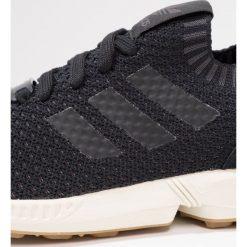 Adidas Originals ZX FLUX PK Tenisówki i Trampki core black. Szare tenisówki damskie marki adidas Originals, z gumy. W wyprzedaży za 439,20 zł.
