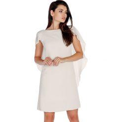 Sukienki hiszpanki: Sukienka w kolorze jasnobeżowym