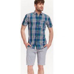 KOSZULA MĘSKA W KRATKĘO DOPASOWANYM KROJU. Brązowe koszule męskie marki QUECHUA, m, z elastanu, z krótkim rękawem. Za 49,99 zł.