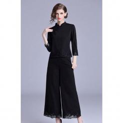 2-częściowy zestaw w kolorze czarnym - bluzka, spodnie. Czarne bluzki nietoperze marki Zeraco, ze stójką. W wyprzedaży za 419,95 zł.