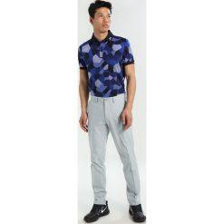 J.LINDEBERG ELOF SLIM FIT LIGHT Spodnie materiałowe stone grey. Niebieskie rurki męskie marki Tiffosi. Za 419,00 zł.
