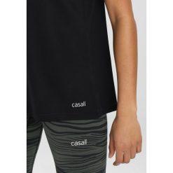 Casall ESSENTIAL RELAXED TANK Top black. Czarne topy sportowe damskie Casall, z elastanu. Za 149,00 zł.