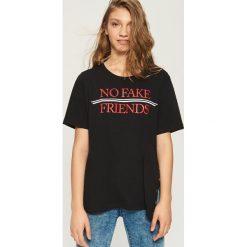 Bawełniany t-shirt oversize - Czarny. Czarne t-shirty damskie marki Sinsay, l, z bawełny. W wyprzedaży za 14,99 zł.