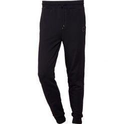 BOSS CASUAL STRIKER Spodnie treningowe black. Czarne spodnie dresowe męskie BOSS Casual, z bawełny. Za 539,00 zł.