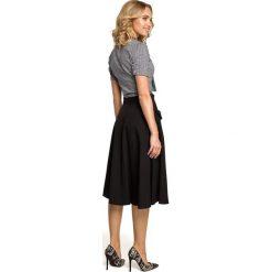 MARVELLA Rozkloszowana spódnica midi z kieszeniami - czarna. Czarne spódnice wieczorowe Moe, s, midi, rozkloszowane. Za 119,00 zł.