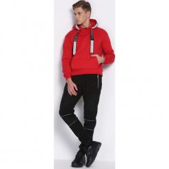 Czarne Spodnie Dresowe Rush. Czarne spodnie dresowe męskie marki Born2be, l, z aplikacjami, z dresówki. Za 49,99 zł.