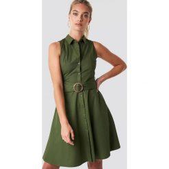 MANGO Sukienka Wendy - Green. Szare sukienki z falbanami marki Mango, na co dzień, l, z tkaniny, casualowe, z dekoltem halter, na ramiączkach, midi, rozkloszowane. Za 141,95 zł.