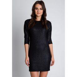 Sukienki asymetryczne: Dzianinowa czarna sukienka z asymetrycznym dołem BIALCON