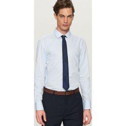 Koszula w kratkę regular fit - Niebieski. Białe koszule męskie w kratę marki Reserved, l, z dzianiny. Za 99,99 zł.