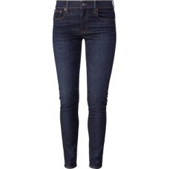 Polo Ralph Lauren SERRET Jeans Skinny Fit dark indigo. Niebieskie jeansy damskie relaxed fit Polo Ralph Lauren, z bawełny. Za 549,00 zł.