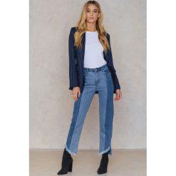 Qontrast X NA-KD Jeansy z asymetrycznym brzegiem - Blue. Niebieskie spodnie z wysokim stanem Qontrast x NA-KD, z jeansu. W wyprzedaży za 121,48 zł.