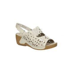 Sandały Rieker  Sandały skórzane ażurowe na koturnie  65695. Szare sandały damskie marki Rieker, w ażurowe wzory, na koturnie. Za 169,99 zł.