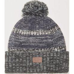 Czapka z pomponem - Niebieski. Czarne czapki zimowe męskie marki KIPSTA, z poliesteru, do piłki nożnej. Za 39,99 zł.