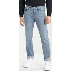 Calvin Klein Jeans SLIM STRAIGHT Jeansy Slim Fit bowie blue. Niebieskie jeansy męskie relaxed fit marki Calvin Klein Jeans, z bawełny. W wyprzedaży za 404,10 zł.