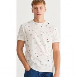 T-shirt z nadrukiem - Kremowy. Niebieskie t-shirty męskie z nadrukiem marki Reserved. Za 39,99 zł.