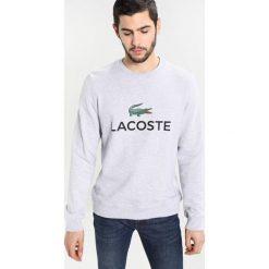 Lacoste Bluza hellgrau meliert. Szare kardigany męskie marki Lacoste, z bawełny. W wyprzedaży za 375,20 zł.