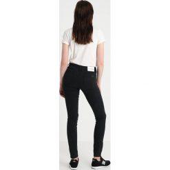 Calvin Klein Jeans CKJ 011 MID RISE SKINNY Jeans Skinny Fit ck black. Czarne jeansy damskie relaxed fit Calvin Klein Jeans, z bawełny. Za 399,00 zł.