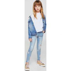 Mango Kids - Jeansy dziecięce Arizona 110-164 cm. Niebieskie jeansy dziewczęce Mango Kids, z aplikacjami, z bawełny. Za 99,90 zł.