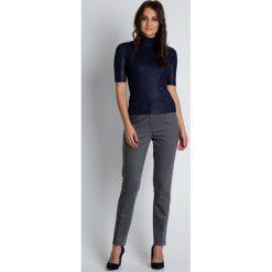 Bluzki asymetryczne: Granatowa dopasowana bluzka z krótkim rękawem i golfem BIALCON