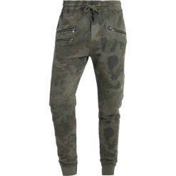 Tigha BEEK Spodnie treningowe natural. Brązowe spodnie dresowe męskie Tigha, z bawełny. Za 379,00 zł.