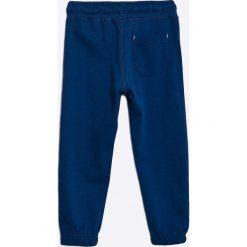 Blukids - Spodnie dziecięce 98-128 cm. Niebieskie spodnie chłopięce Blukids, z bawełny. W wyprzedaży za 39,90 zł.