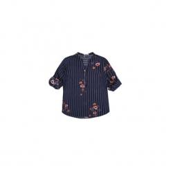 Bluzka tkanina z guziczkami ze stójką w paski, w kwiaty. Czarne bluzki z odkrytymi ramionami marki TXM, w kwiaty, z tkaniny, ze stójką. Za 39,99 zł.