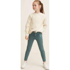 Mango Kids - Jeansy dziecięce Patri 110-164 cm. Szare rurki dziewczęce Mango Kids, z aplikacjami, z bawełny. Za 89,90 zł.