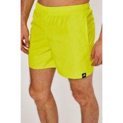 Adidas Performance - Szorty. Żółte spodenki sportowe męskie marki adidas Performance, z materiału, sportowe. W wyprzedaży za 99,90 zł.