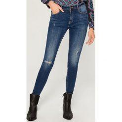 Jeansy skinny high waist - Niebieski. Niebieskie spodnie z wysokim stanem marki Mohito, z jeansu. Za 119,99 zł.