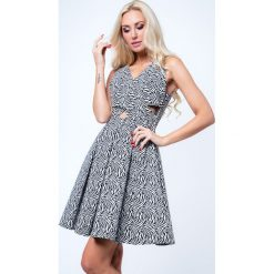 Sukienki hiszpanki: Sukienka rozkloszowana motyw zwierzęcy biało-czarna G5011