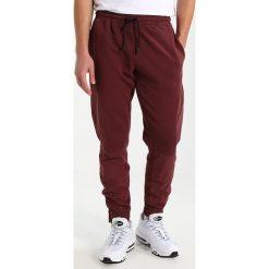 Spodnie męskie: New Look CONTRAST PANNEL ZIP  Spodnie treningowe dark burgundy