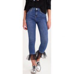 Topshop JAMIE Jeans Skinny Fit middenim. Niebieskie jeansy damskie relaxed fit marki Topshop. W wyprzedaży za 202,30 zł.