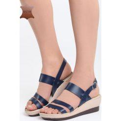 Granatowe Skórzane Sandały Own Self. Niebieskie sandały damskie marki Born2be, z materiału, na koturnie. Za 99,99 zł.