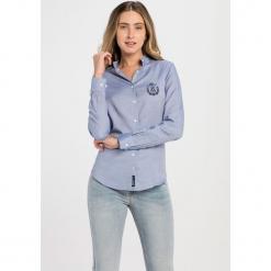 Koszula w kolorze niebieskim. Niebieskie koszule damskie Jimmy Sanders, l, z klasycznym kołnierzykiem. W wyprzedaży za 82,95 zł.