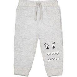 Spodnie dresowe z fantazyjnym nadrukiem - 1 miesięcy - 3 lata. Szare spodnie dresowe dziewczęce La Redoute Collections, z nadrukiem, z bawełny. Za 55,82 zł.