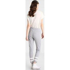 GStar SCOLLA SLIM PANT Spodnie treningowe grey heather. Szare rurki damskie marki G-Star. W wyprzedaży za 356,15 zł.