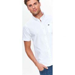KOSZULA KRÓTKI RĘKAW MĘSKA. Brązowe koszule męskie marki QUECHUA, m, z elastanu, z krótkim rękawem. Za 34,99 zł.